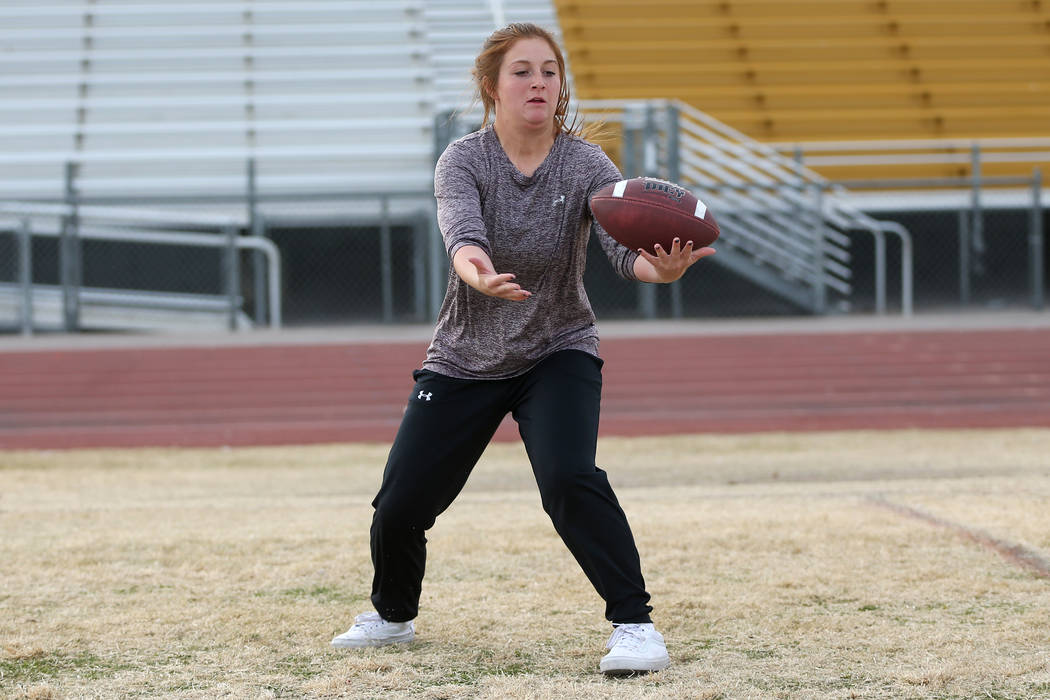 Bonanza's flag football running back Charlene Beck, 16, reaches for the ball during a workout at Bonanza High School in Las Vegas, Tuesday, Nov. 27, 2018. Erik Verduzco Las Vegas Review-Journal @E ...