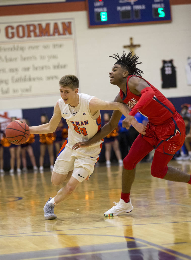 Bishop Gorman's Noah Taitz (20) drives the ball against Coronado's Jaden Hardy (1) during the first half of a varsity basketball game at Bishop Gorman High School in Las Vegas on Thursday, Nov. 29 ...