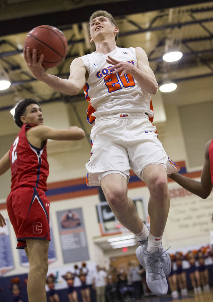 Bishop Gorman's Noah Taitz (20) goes up for a shot against Coronado during the first half of a varsity basketball game at Bishop Gorman High School in Las Vegas on Thursday, Nov. 29, 2018. Richard ...
