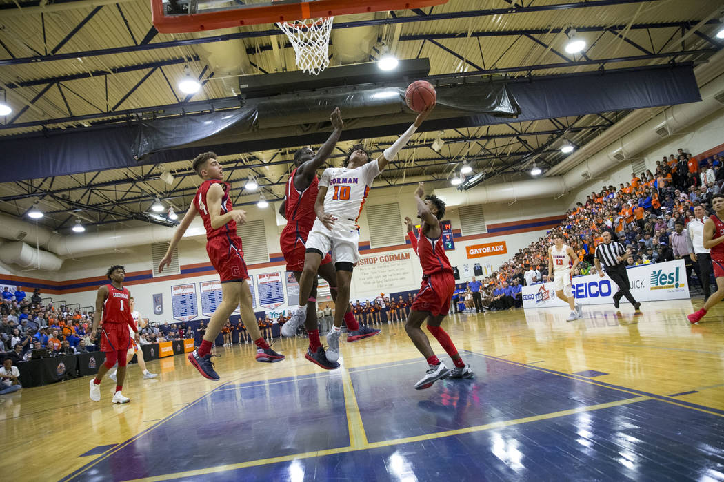 Bishop Gorman's Zaon Collins (10) takes a shot against Coronado defenders during the first half of a varsity basketball game at Bishop Gorman High School in Las Vegas on Thursday, Nov. 29, 2018. R ...