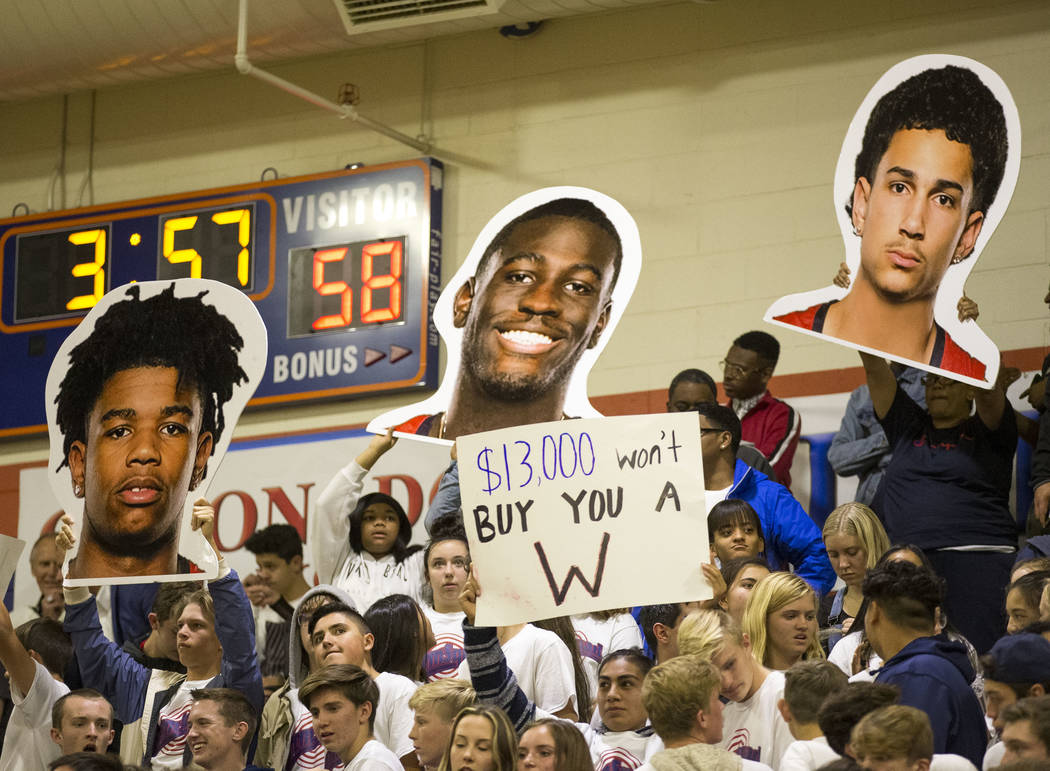 Coronado fans holds up signs during the second half of a varsity basketball game against Bishop Gorman at Bishop Gorman High School in Las Vegas on Thursday, Nov. 29, 2018. Richard Brian Las Vegas ...
