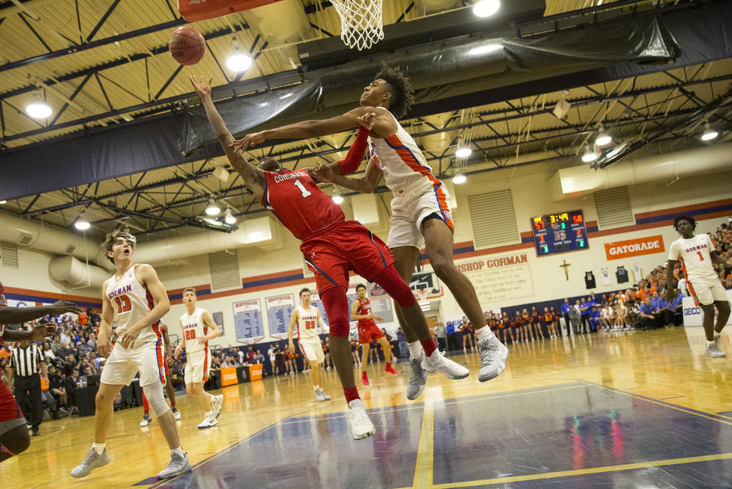 Coronado's Jaden Hardy (1) gets blocked by Bishop Gorman's Isaiah Cottrell (0) during the second half of a varsity basketball game at Bishop Gorman High School in Las Vegas on Thursday, Nov. 29, 2 ...