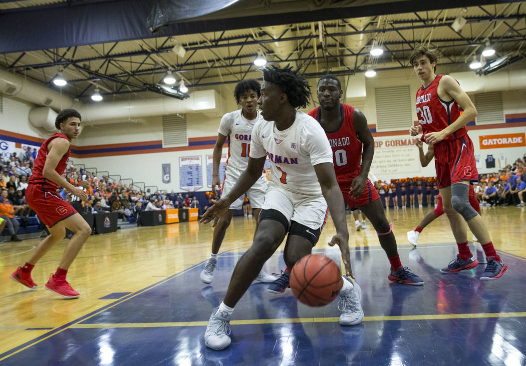 Bishop Gorman's Will McClendon (1) looks to pass against Coronado during the first half of a varsity basketball game at Bishop Gorman High School in Las Vegas on Thursday, Nov. 29, 2018. Richard B ...