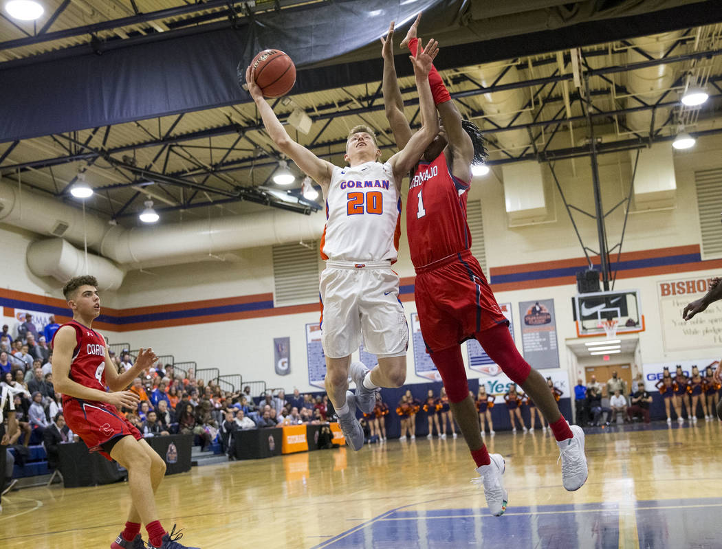 Bishop Gorman's Noah Taitz (20) shoots as Coronado's Jaden Hardy (1) defends the net during the first half of a varsity basketball game at Bishop Gorman High School in Las Vegas on Thursday, Nov. ...