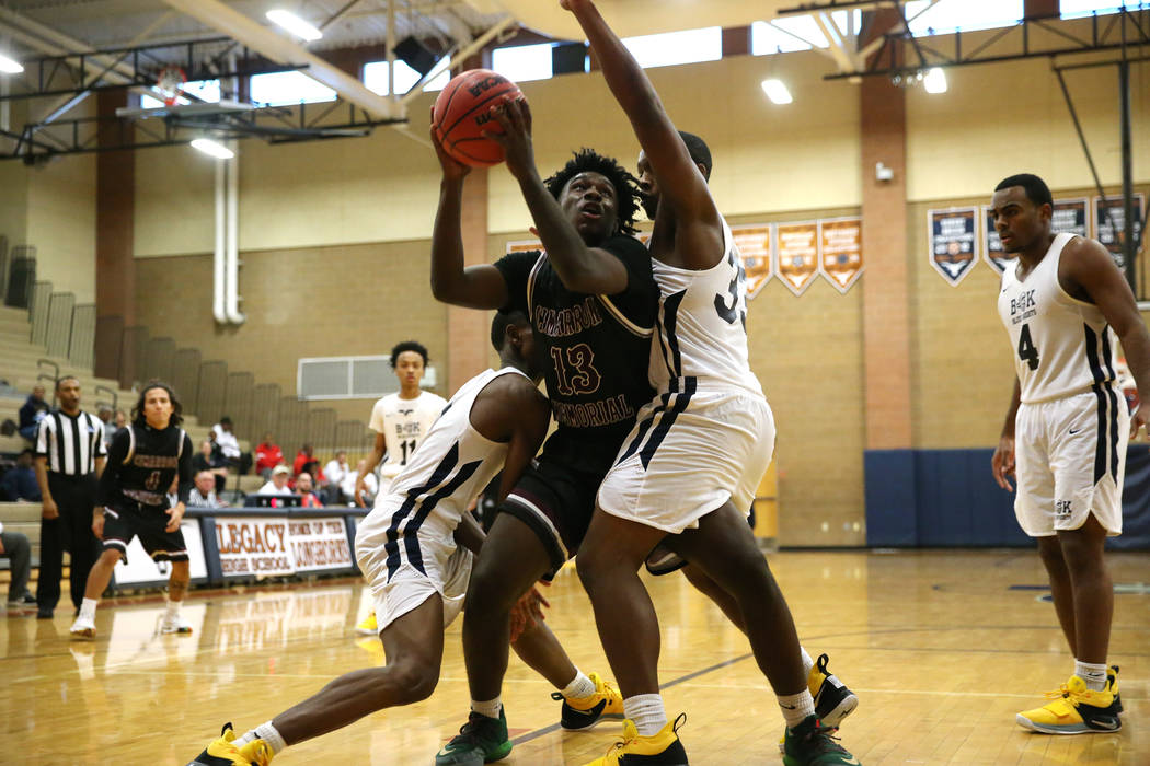Cimarron-Memorial's Brian Lang (13) looks for an open shot against Democracy Prep's Sayvyon Smith (33) in their basketball game at Legacy High School in North Las Vegas, Friday, Nov. 30, 2018. Eri ...