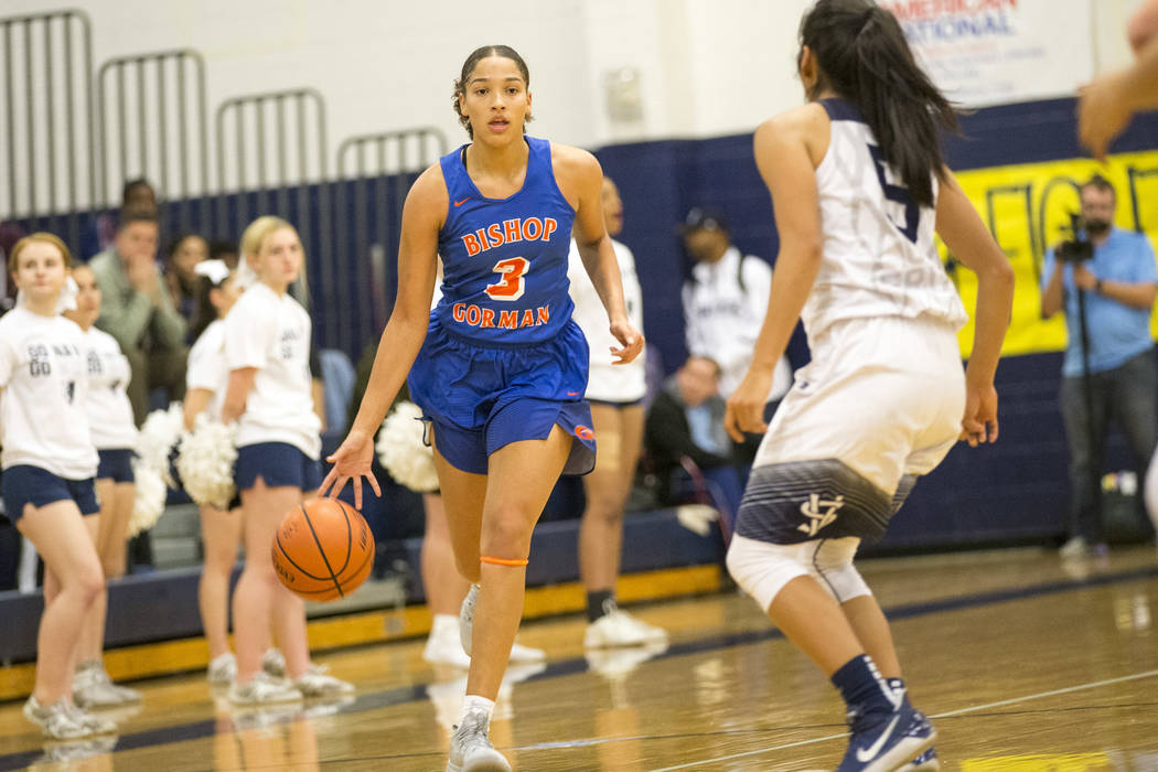 Bishop Gorman's Georgia Ohiaeri (3) dribbles the ball as Spring Valley's Chelsea Camara (5) defends during the first half of a varsity basketball game at Spring Valley High School in Las Vegas on ...