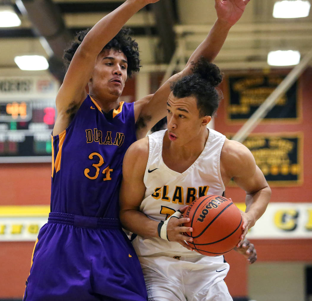 Clark senior forward Ian Alexander (32) protects the ball while under pressure from Durango's Tyson Guild (34) at Clark High School in Las Vegas, Tuesday, Dec. 4, 2018. Caroline Brehman/Las Vegas ...