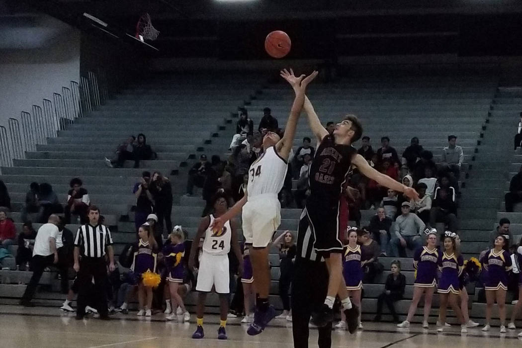 Desert Oasis' Cade Savell and Durango's Tyson Guild go for the opening tip on Thursday, Dec. 7, 2018 at Durango High. The Trailblazers won, 71-61 (Damon Seiters/Las Vegas Review-Journal)