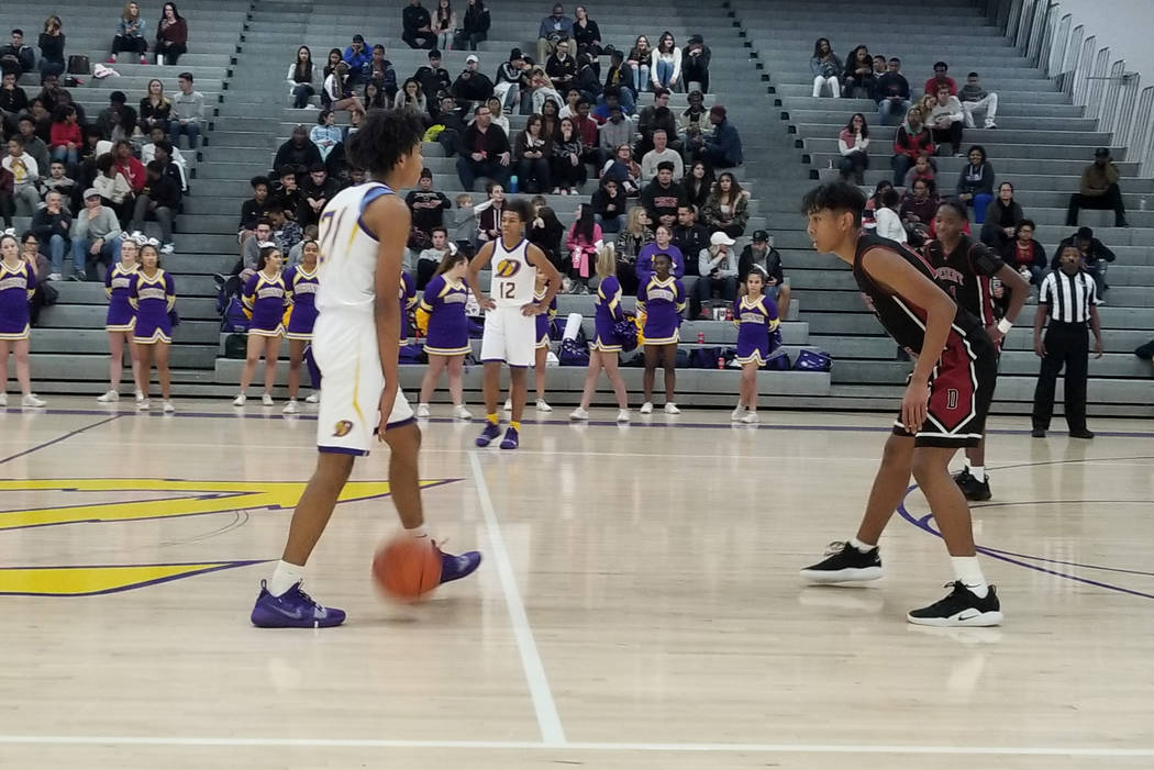 Durango's Anthony Hunter, left, brings the ball up the court against Desert Oasis' Nate Van on Thursday, Dec. 7, 2018 at Durango High. The Trailblazers won, 71-61 (Damon Seiters/Las Vegas Review-J ...