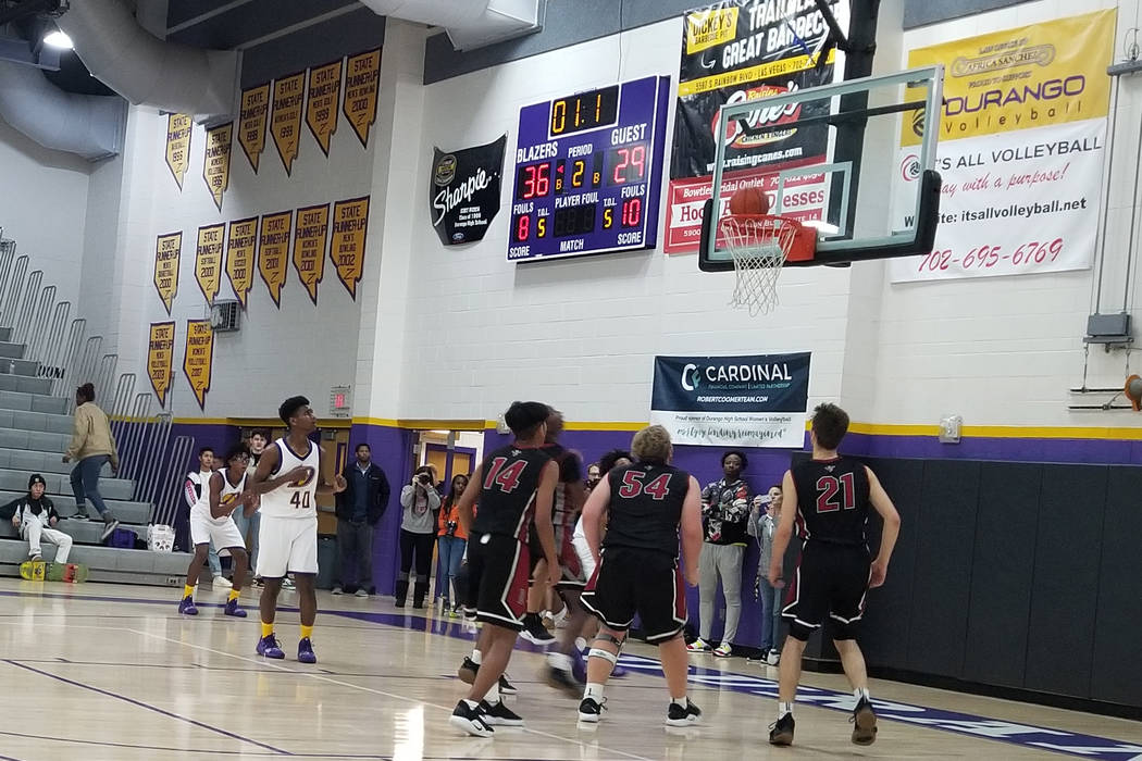 Desert Oasis players look on as Anthony Hunter's first-half buzzer-beater falls on Thursday, Dec. 7, 2018 at Durango High. The Trailblazers won, 71-61 (Damon Seiters/Las Vegas Review-Journal)