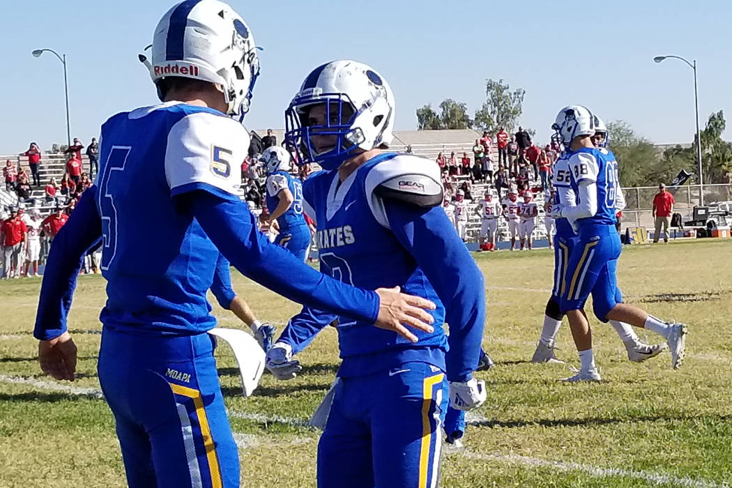 Moapa Valley's Chase Hoy, left, congratulates quarterback Luke Bennett after his first-half touchdown pass on Saturday, Nov. 10, 2018. Truckee beat the Pirates 23-16 in a Class 3A state semifinal ...