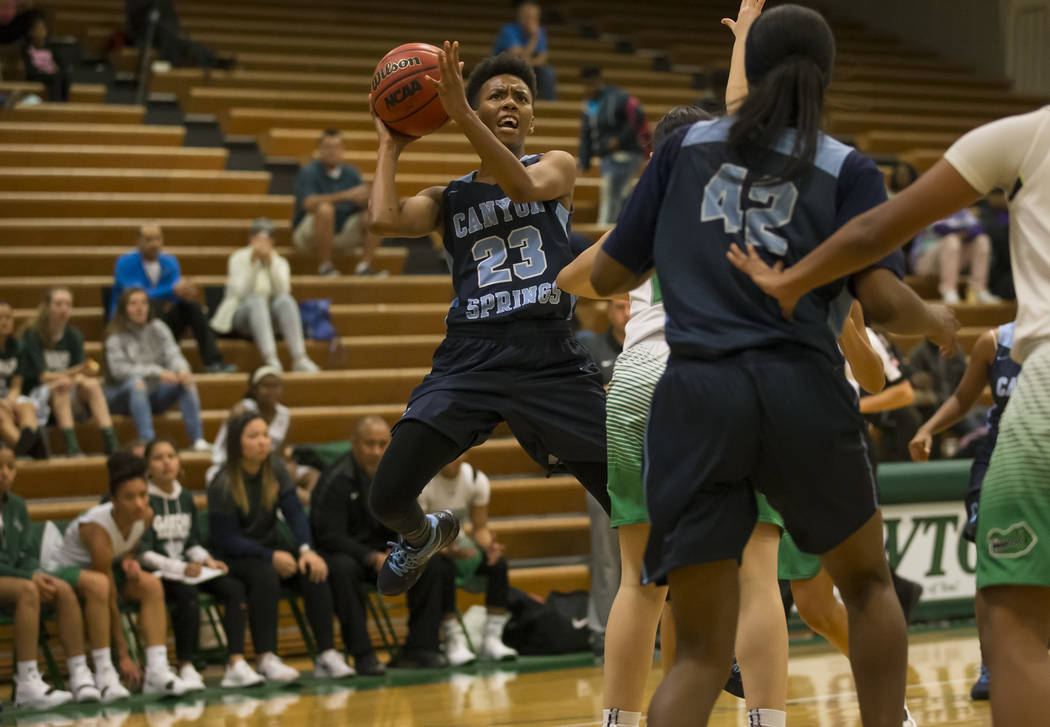 Canyon Springs guard Kayla Johnson (23) takes a shot against Green Valley during the first half of a varsity basketball game at Green Valley High School in Henderson on Friday, Dec. 7, 2018. Richa ...