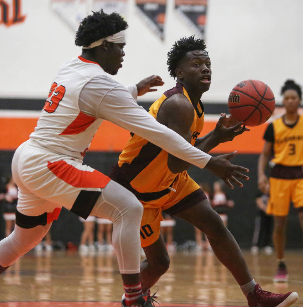 Eldorado's Grayling Atkins (10) dribbles the ball while under pressure from Chaparral's Dejonte Allen (23) during the second half of a basketball game at Chaparral High School in Las Vegas, Monday ...