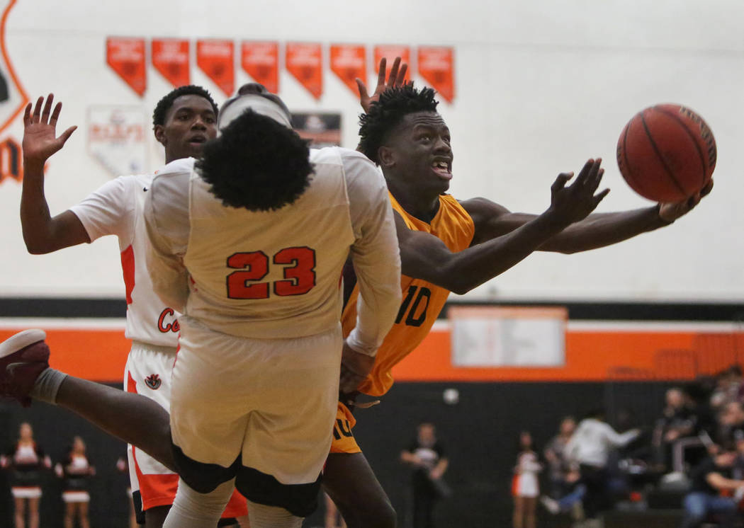 Eldorado's Grayling Atkins (10) dodges Chaparral's Dejonte Allen (23) with the ball during the second half of a basketball game at Chaparral High School in Las Vegas, Monday, Dec. 10, 2018. Caroli ...