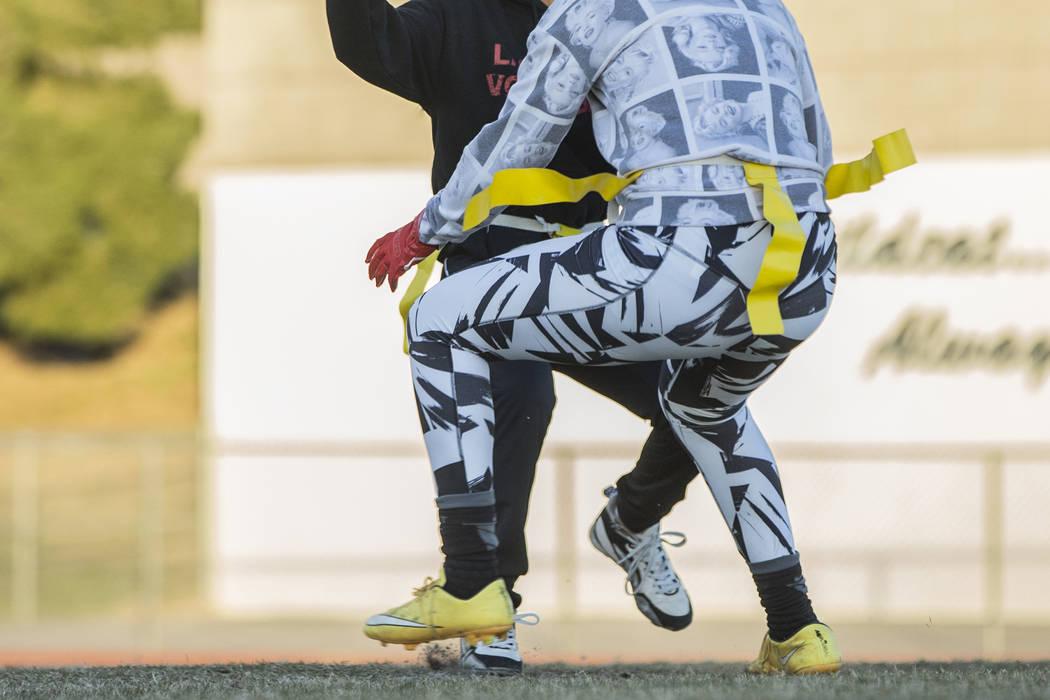Las Vegas quarterback Sabrina Saldate dishes the ball before being tackled during flag football practice at Las Vegas High School on Monday, Nov. 28, 2016, in Las Vegas. Benjamin Hager/Las Vegas R ...