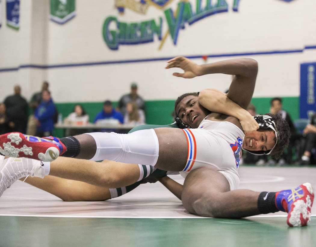 Valley's Keayon Morris, front, wrestles Green Valley's Noah Hawthorne during their 182 lb. match on Thursday, Nov. 29, 2018, at Green Valley High School, in Henderson. Benjamin Hager Las Vegas Rev ...