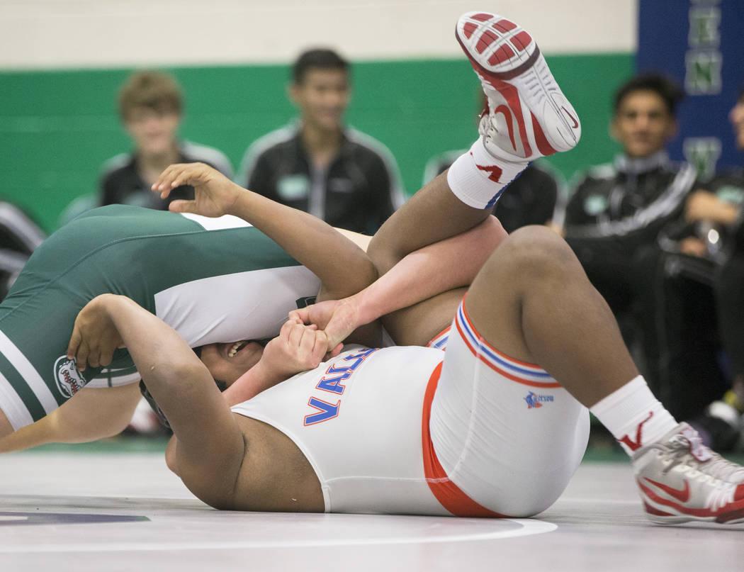 Valley's Xzavier Maheia, bottom, wrestles Green Valley's Desmond Bowers during their 170 lb. match on Thursday, Nov. 29, 2018, at Green Valley High School, in Henderson. Benjamin Hager Las Vegas R ...