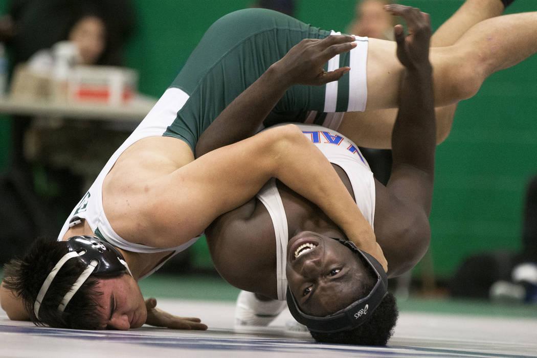 Valley's Xzavier Maheia, right/bottom, wrestles Green Valley's Desmond Bowers during their 170 lb. match on Thursday, Nov. 29, 2018, at Green Valley High School, in Henderson. Benjamin Hager Las V ...