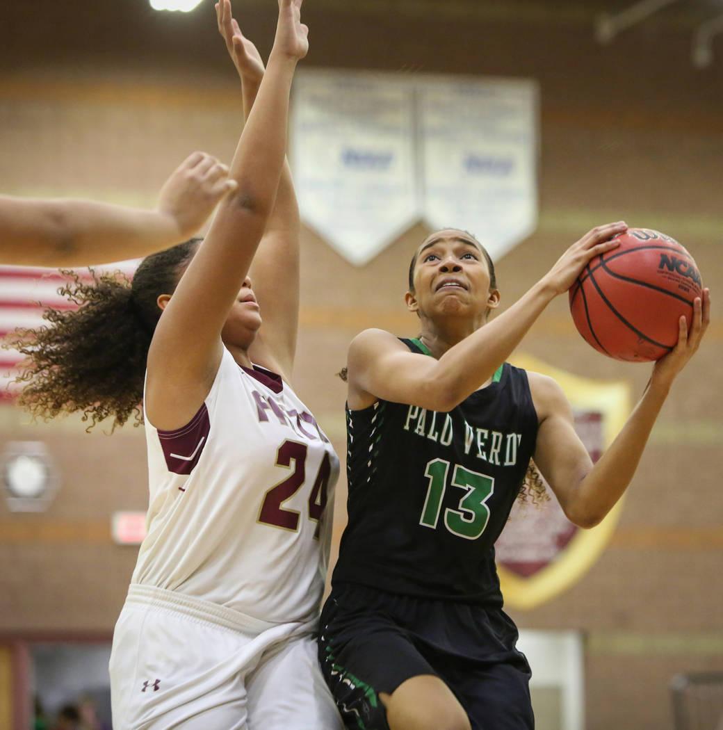 Palo Verde's Kedrena Johnson (13) looks to shoot the ball while under pressure from Faith Lutheran's Kayla Proctor (24) at Faith Lutheran High School in Las Vegas, Thursday, Dec. 13, 2018. Carolin ...