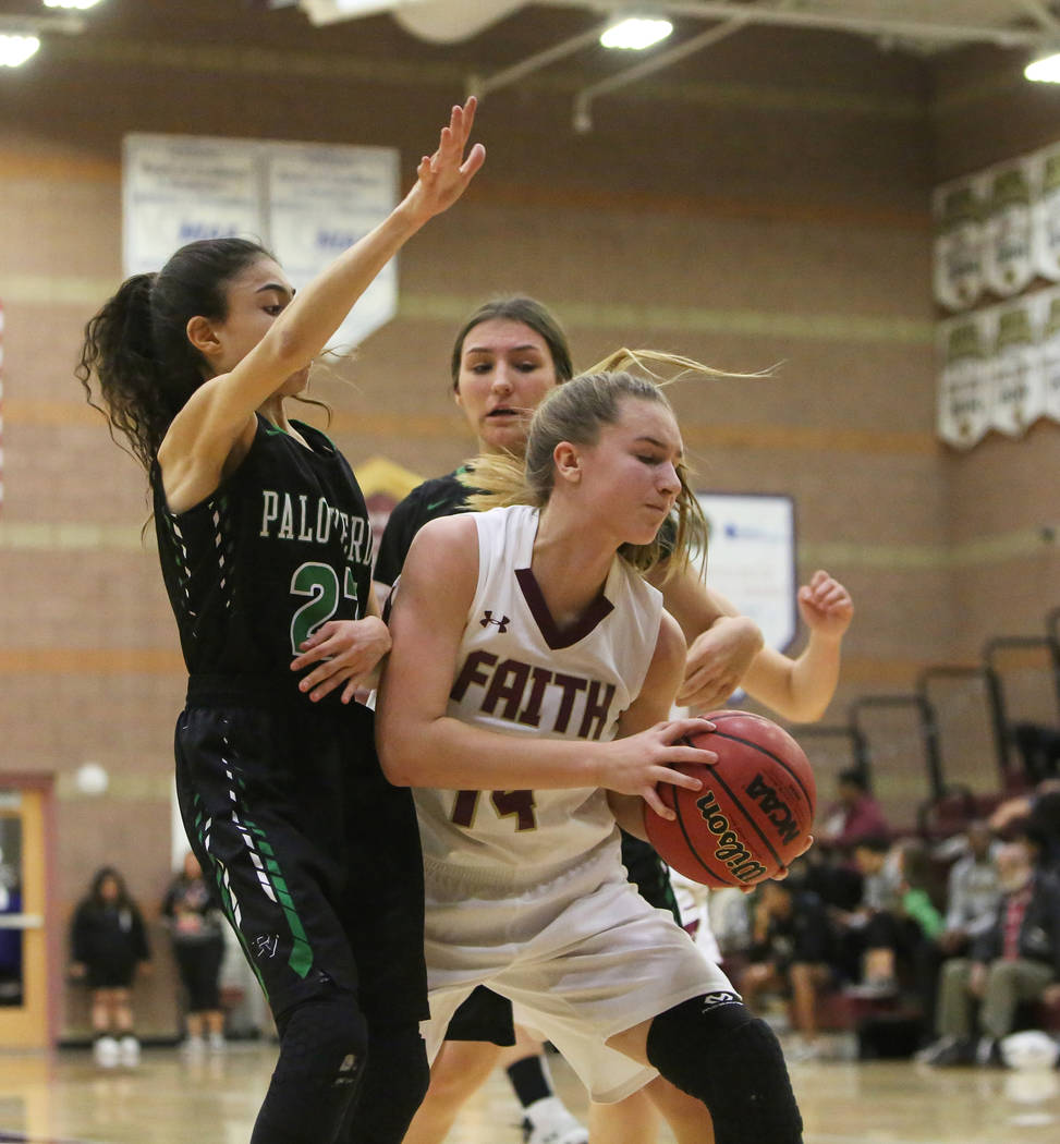 Faith Lutheran's Ellie Fried (14) shields the ball while under pressure from Palo Verde's Maya Bega (23) at Faith Lutheran High School in Las Vegas, Thursday, Dec. 13, 2018. Caroline Brehman/Las V ...