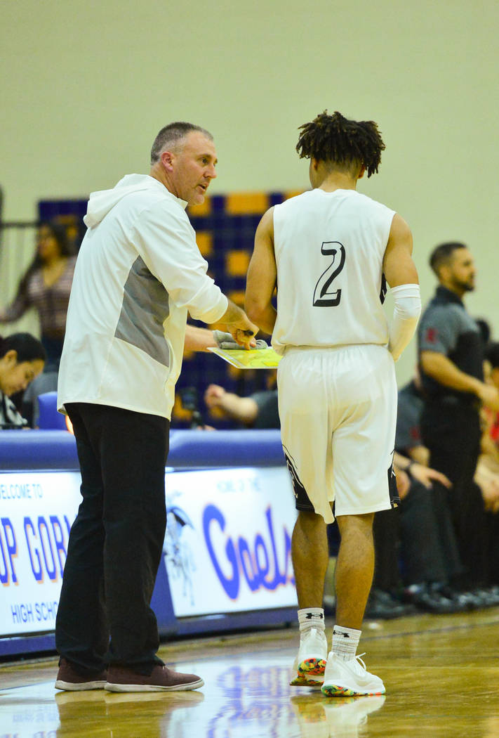 Faith Lutheran head coach Bret Walter talks to Donavan Jackson (2) during a game between Liberty High School and Faith Lutheran at Bishop Gorman High School in Las Vegas on Saturday, Dec. 15, 2018 ...