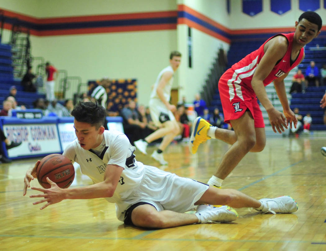 A loose ball slips through the hands of Faith Lutheran's Raymond Rosolino (14) in the fourth quarter of a game between Liberty High School and Faith Lutheran at Bishop Gorman High School in Las Ve ...