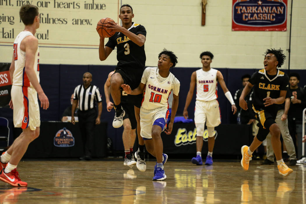 Clark Chargers' Greg Foster Jr (3) shoots the ball during the final seconds of the first half of the platinum division championship basketball game of the Tarkanian Classic against Bishop Gorman a ...