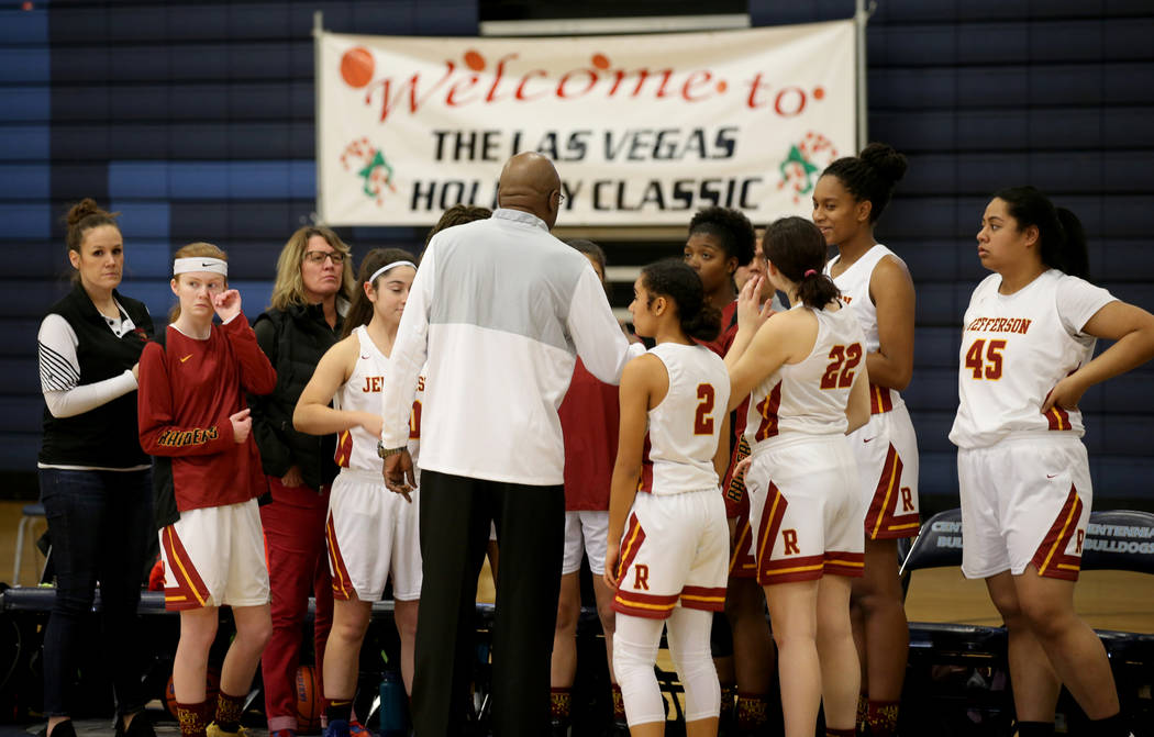 Thomas Jefferson (Wash.) Coach Frank Parker gives instruction before his team takes on Palo Verde in the Las Vegas Holiday Classic Tournament at Centennial High School in Las Vegas,Thursday, Dec. ...