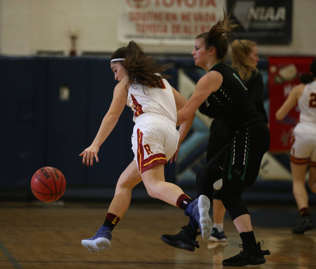 Thomas Jefferson (Wash.) guard Hailey Still moves the ball up the court past Palo Verde guard Alyssa Maillaro in the first quarter of their Las Vegas Holiday Classic Tournament prep basketball gam ...