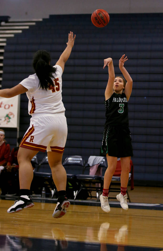 Palo Verde guard Jenna Kempf (3) shoots over Thomas Jefferson (Wash.) forward Hila Vei'koso (45) in the first quarter of their Las Vegas Holiday Classic Tournament prep basketball game at Centenni ...