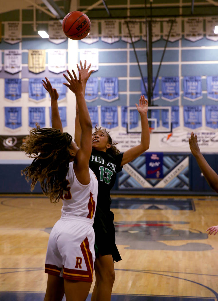 Palo Verde forward Kedrena Johnson (13) shoots over Thomas Jefferson (Wash.) Gjianni White (15) in the fourth quarter of their Las Vegas Holiday Classic Tournament prep basketball game at Centenni ...