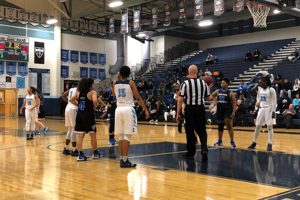 Centennial players line up alongside the lane as a Bear Creek player shoots a free throw at Centennial High School on Friday, December 28, 2018. Sam Gordon/Las Vegas Review-Journal.