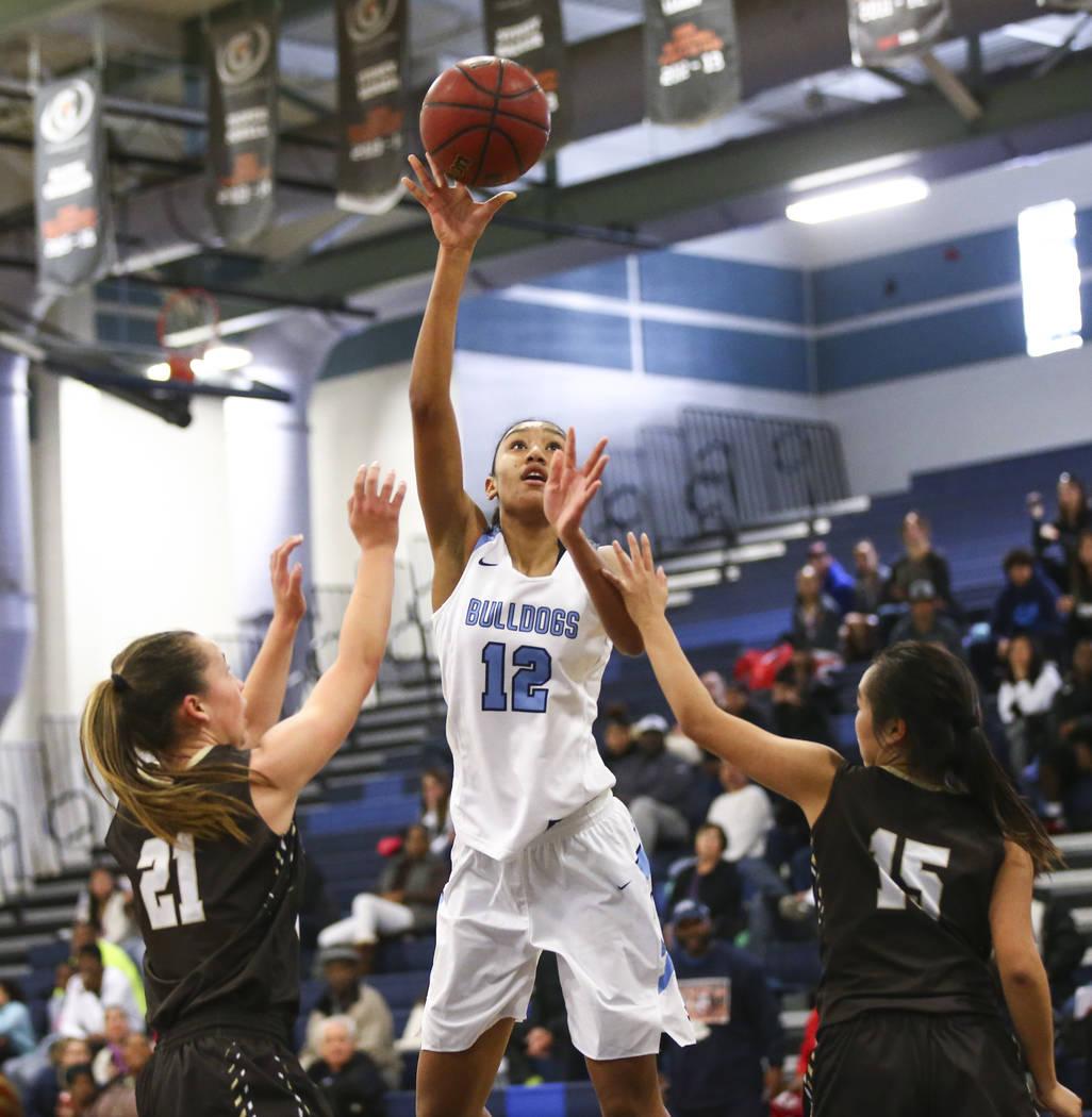 Centennial's Aishah Brown (12) shoots between WestÕs Ella Estabrook (21) and West's Rachel Arakawa (15) during a basketball game at Centennial High School in Las Vegas on Saturday, Dec. 29, 2018. ...