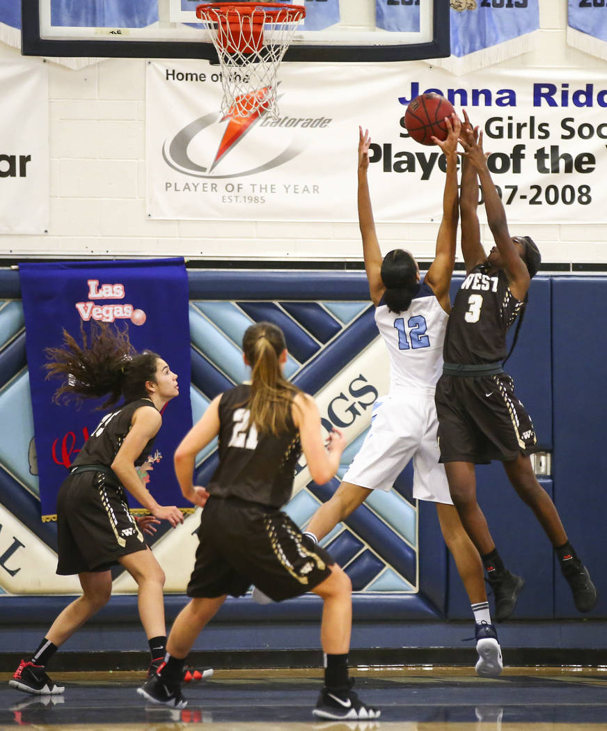Centennial's Aishah Brown (12) blocks a shot from West's Anaya James (3) during a basketball game at Centennial High School in Las Vegas on Saturday, Dec. 29, 2018. Chase Stevens Las Vegas Review- ...