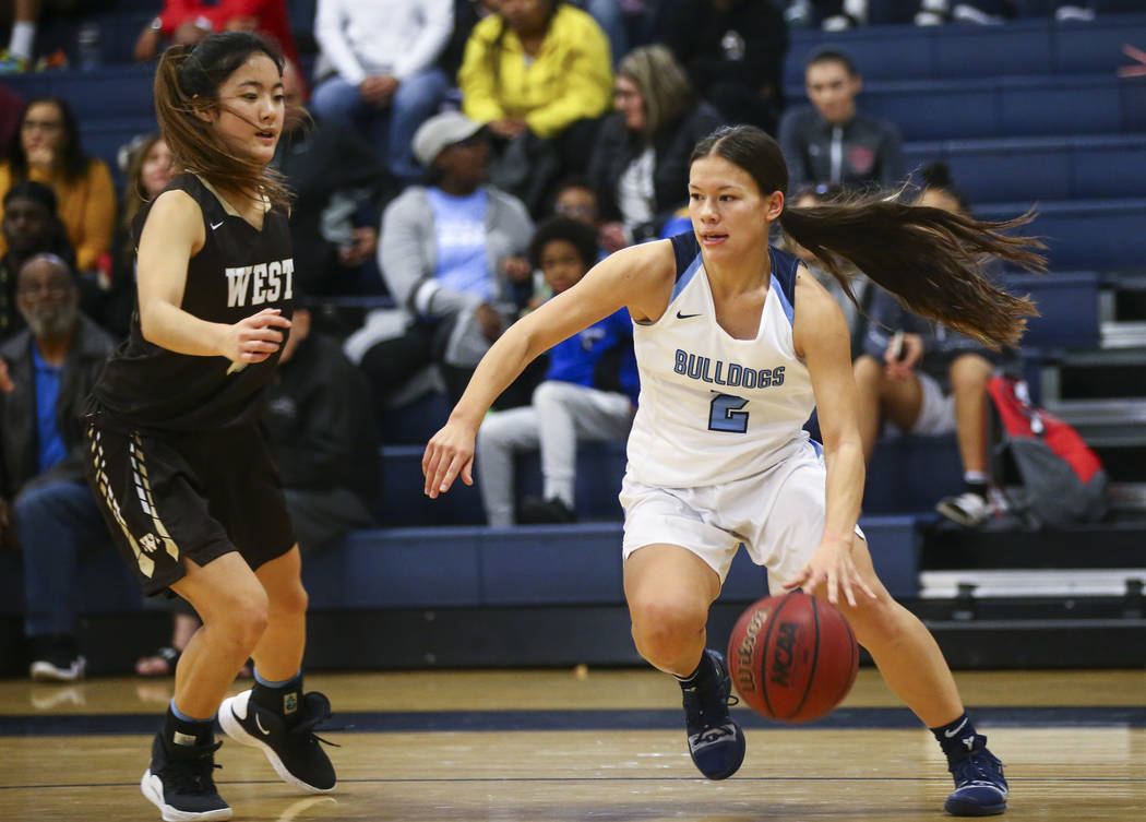 Centennial's Melanie Isbell (2) moves the ball around West's Alisa Saito (5) during a basketball game at Centennial High School in Las Vegas on Saturday, Dec. 29, 2018. Chase Stevens Las Vegas Rev ...