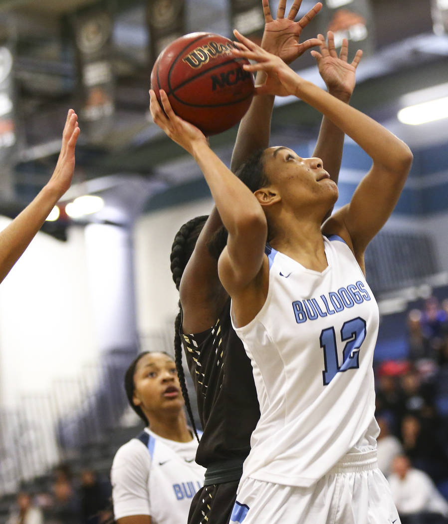 Centennial's Aishah Brown (12) looks to shoot against West during a basketball game at Centennial High School in Las Vegas on Saturday, Dec. 29, 2018. Chase Stevens Las Vegas Review-Journal @csste ...