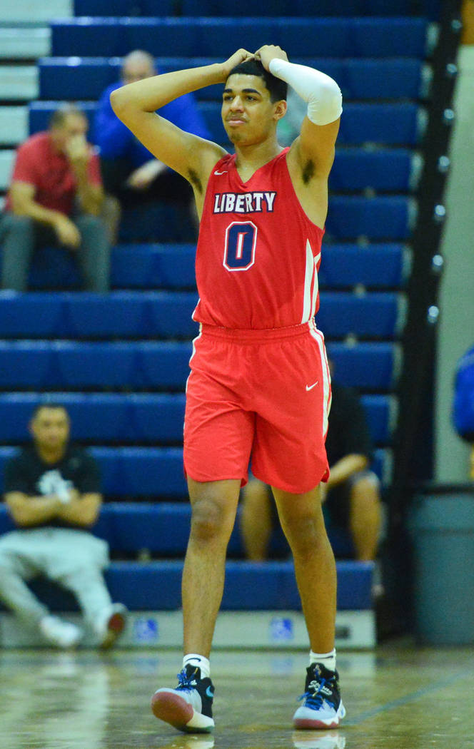 Liberty's Julian Strawther (0) reacts to a foul call in the fourth quarter of a game between Liberty High School and Faith Lutheran at Bishop Gorman High School in Las Vegas on Saturday, Dec. 15, ...