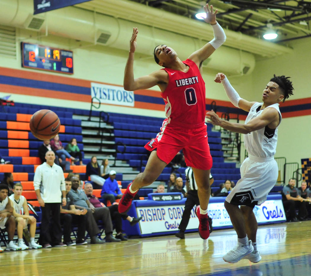 Liberty's Julian Strawther (0) draws a foul in the first quarter of a game between Liberty High School and Faith Lutheran at Bishop Gorman High School in Las Vegas on Saturday, Dec. 15, 2018. Fait ...
