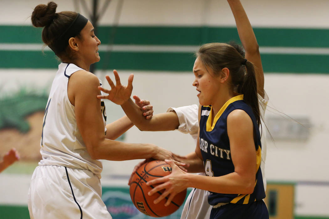 Boulder City's Keely Alexander (14) is pressured by Foothill's Yareth Arse (4) in the girl's basketball game at Green Valley High School in Henderson, Wednesday, Jan. 2, 2019. Erik Verduzco Las Ve ...