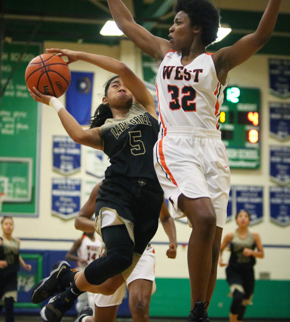 Spring Valley's Chelsea Camara (5) drives past West Anchorage's Ah'Kayzee Galloway (32) during the first half of a basketball game at Green Valley High School in Henderson, Thursday, Jan. 3, 2019. ...