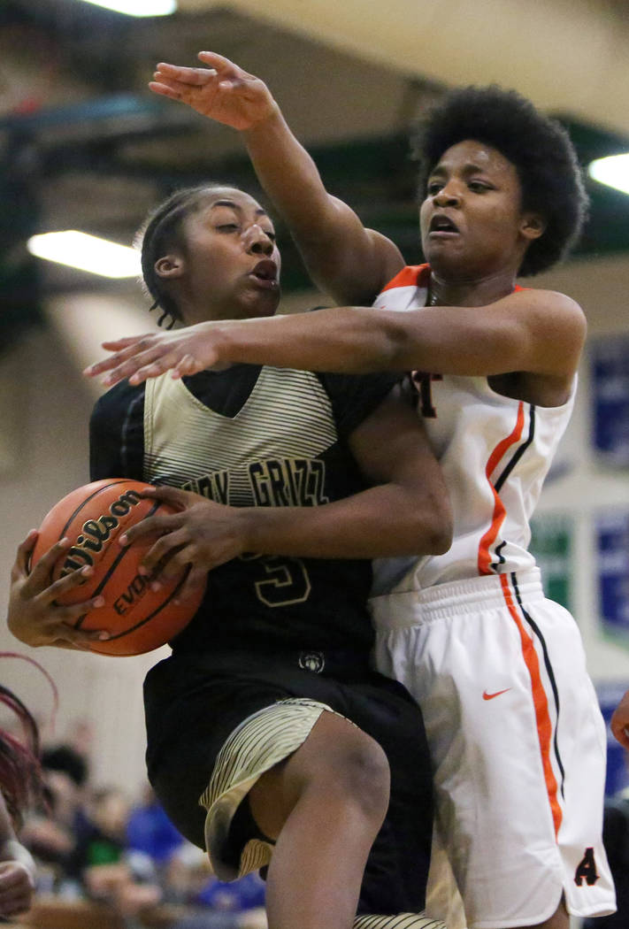 Spring Valley's Aaliyah Gayles (3) shields the ball from West Anchorage's Ah'Kayzee Galloway (32) during the first half of a basketball game at Green Valley High School in Henderson, Thursday, Jan ...