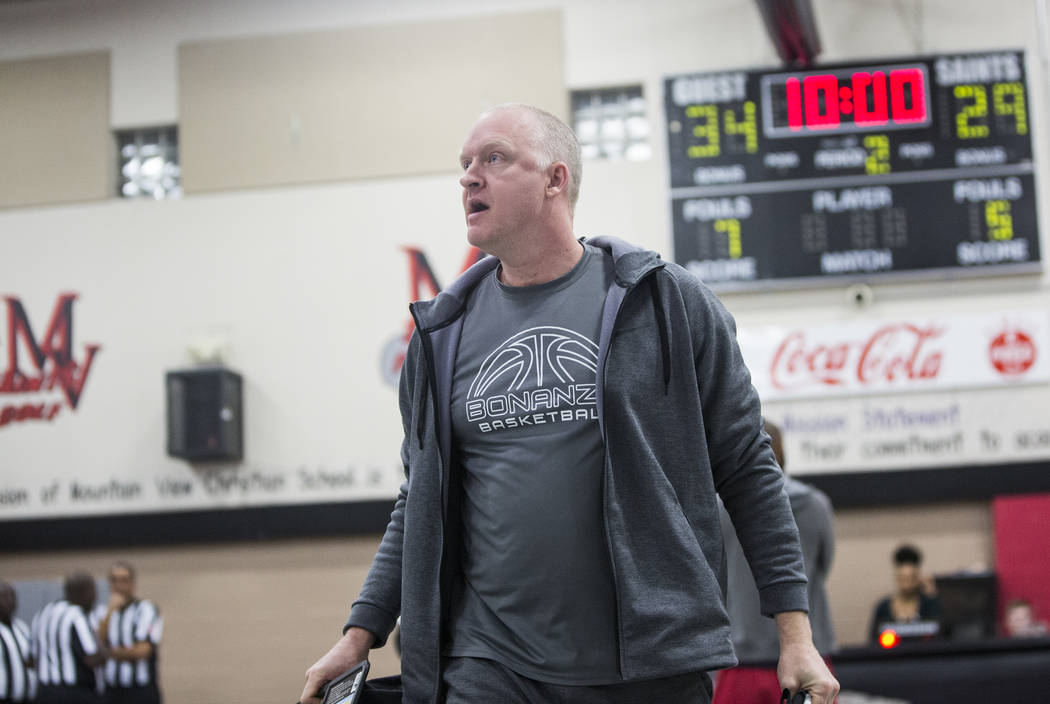Bonanza head coach Dan Savage walks off the court in anger after the Bengals game with Sierra Vista was suspended and ultimately forfeited after an on court incident at halftime during the semifin ...