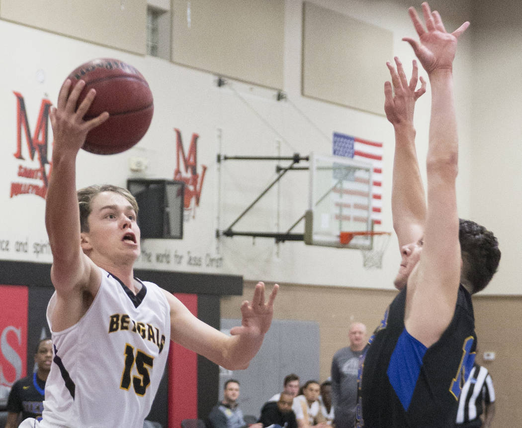 Bonanza junior Baylee Osborne (15) drives past Sierra Vista junior Valton Mesic (14) in the second quarter during the semifinals of the Vegas Invitational boys basketball tournament on Friday, Jan ...