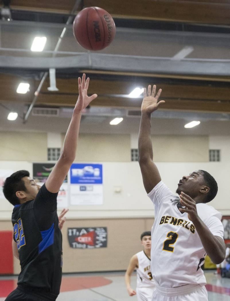Bonanza senior Joseph Brooks (2) shoots a baseline floater over Sierra Vista sophomore Lowell Chan (22) in the second quarter during the semifinals of the Vegas Invitational boys basketball tourna ...