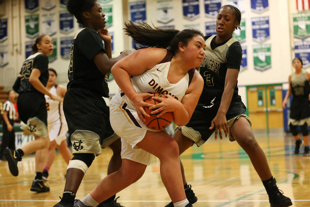 Dimond's Kayla Pili (32) is pressured by Spring Valley's Aaliyah Gayles (3) in the Diamond bracket championship basketball game at Green Valley High School in Henderson, Saturday, Jan. 5, 2019. Er ...