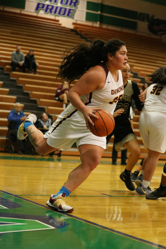 Dimond's Alissa Pili (35) looks for an open pass as she steps out of bounds against Spring Valley in the Diamond bracket championship basketball game at Green Valley High School in Henderson, Satu ...