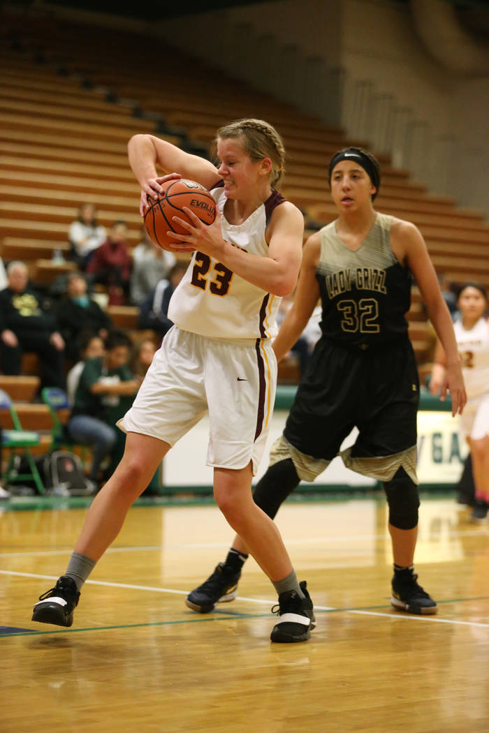 Dimond's Larissa Parker (23) collects a rebound as Spring Valley's Garrisen Freeman (32) looks on in the Diamond bracket championship basketball game at Green Valley High School in Henderson, Satu ...