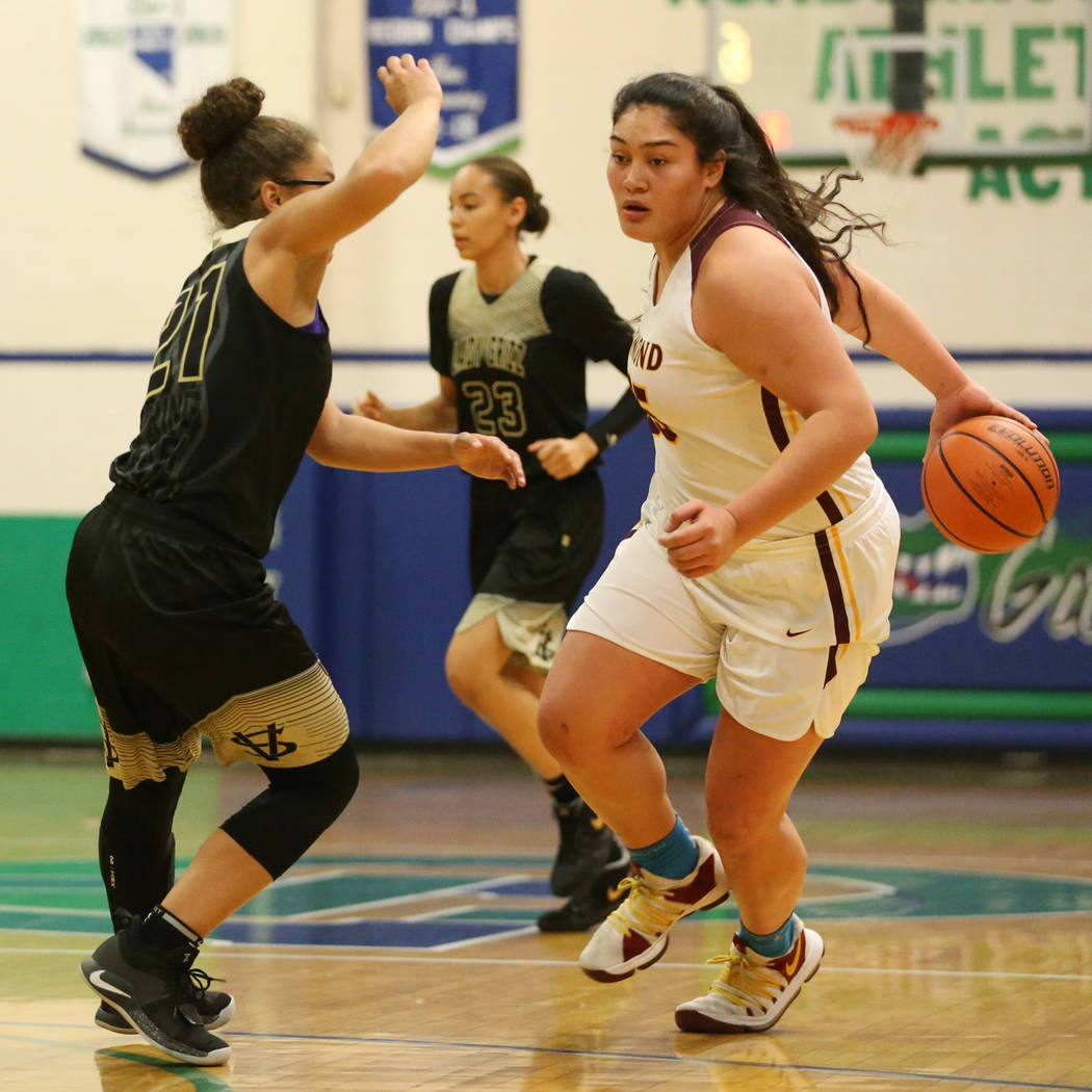 Dimond's Alissa Pili (35) dribbles the ball around her back against Spring Valley's Ella Zanders (21) in the Diamond bracket championship basketball game at Green Valley High School in Henderson, ...