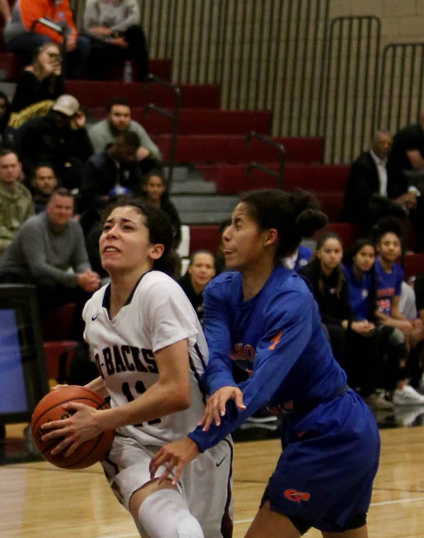 Desert Oasis High School's Olivia Bigger (11) tries to pass through Bishop Gorman High School's Caira Young (1) at Desert Oasis High School in Las Vegas, Tuesday, Jan. 8, 2019. Bishop Gorman won 4 ...