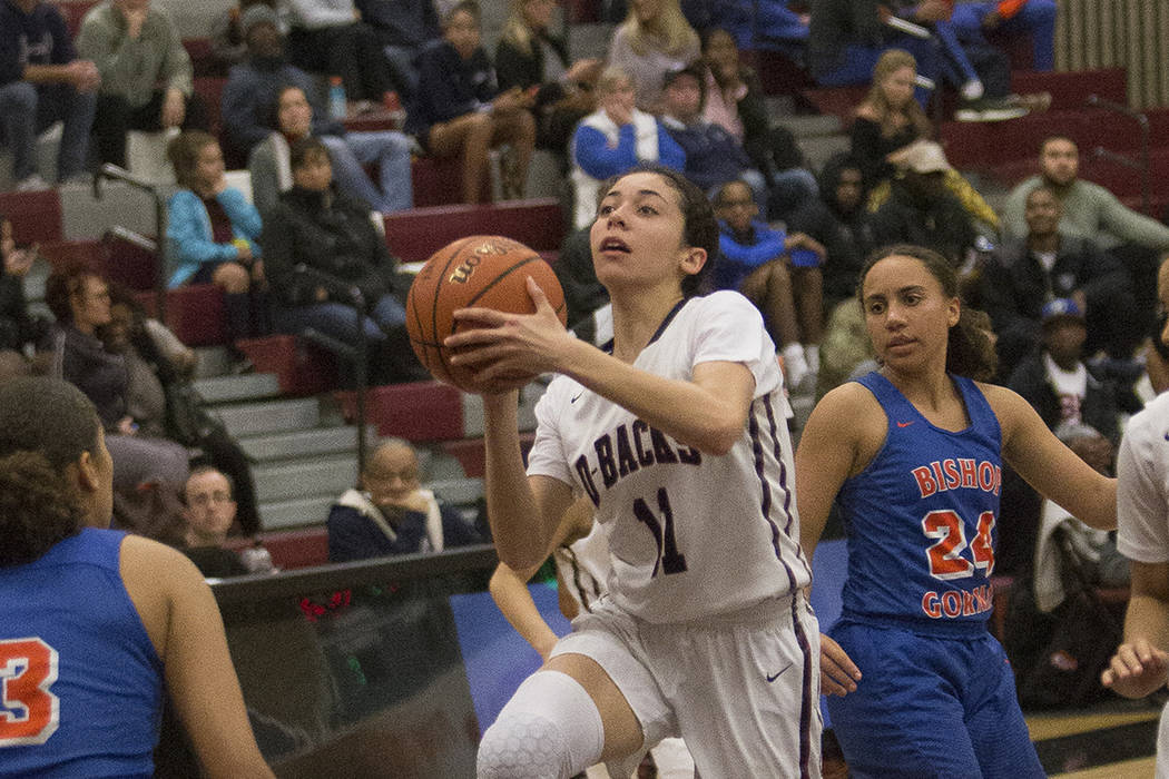Desert Oasis High School's Olivia Bigger (11) attempts a shot in a game against Bishop Gorman High School at Desert Oasis High School in Las Vegas, Tuesday, Jan. 8, 2019. Bishop Gorman won 45-34. ...